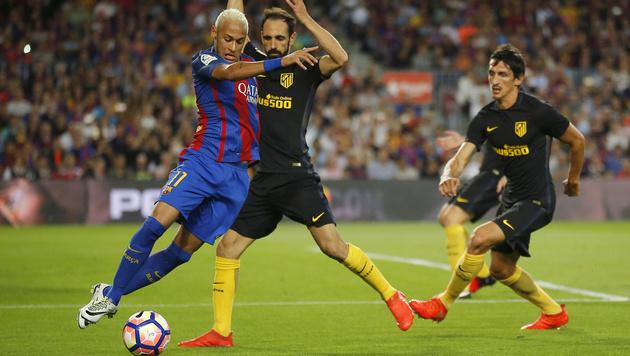 Barca gegen Atletico 1:1 - Messi verletzt (Bild: AP)