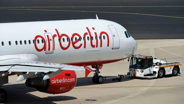 Air-Berlin-Crews melden sich wieder zur Arbeit (Bild: APA/AFP/Patrik Stollarz)