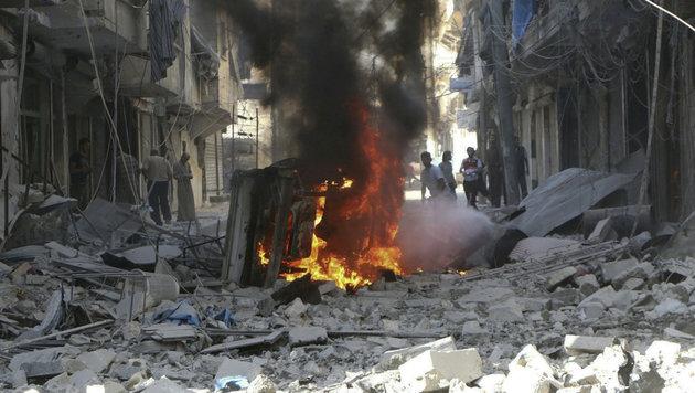 Ein völlig zerstörter Straßenzug in Aleppo (Bild: Associated Press)