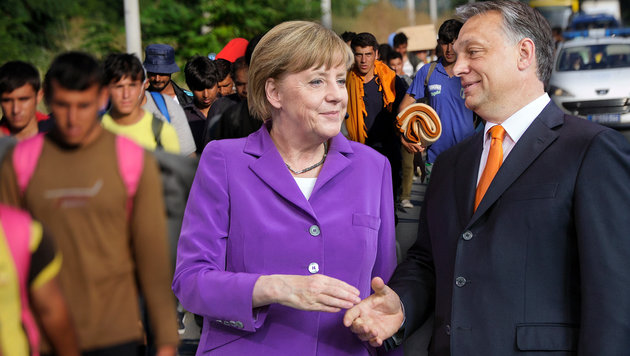 "Merkel und Orban: Munkeln über Asyl-""Geheimpakt"" (Bild: APA/AFP/OLIVER BUNIC, APA/dpa/Hannibal Hanschke)"