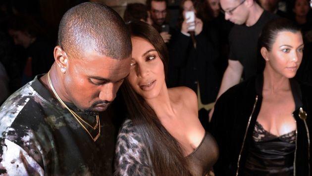Kim Kardashian und Kanye West bei der Fashion Week in Paris (Bild: AFP)