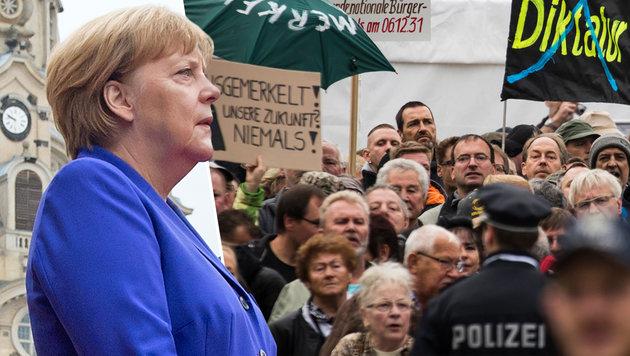 Deutschland: Linken-Chef ruft zum Merkel-Sturz auf (Bild: AFP/ODD ANDERSEN, AP/Jens Meyer)