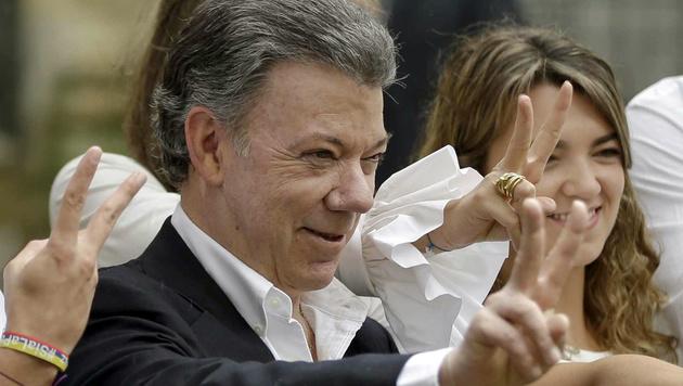 Friedensnobelpreis für Kolumbiens Präsident Santos (Bild: ASSOCIATED PRESS)