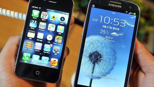 Patentstreit: Wie viel muss Samsung Apple zahlen? (Bild: APA/AFP/JUNG YEON-JE)