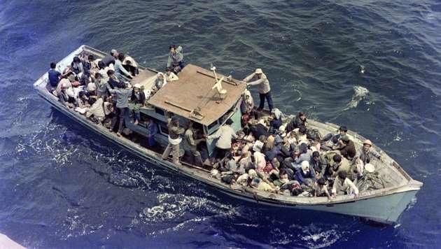 Ein Foto vom 8. Juli 1979 zeigt vietnamesische Flüchtlinge im Südchinesischen Meer. (Bild: AFP)