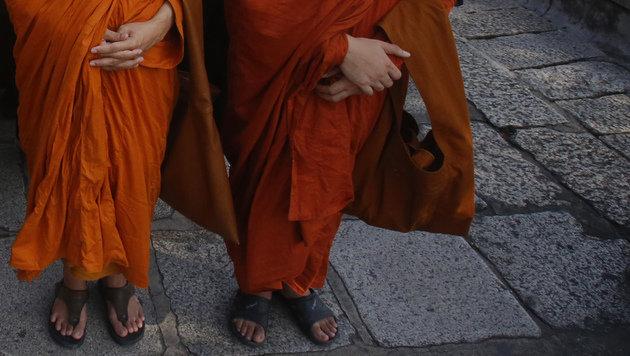 Falsche Buddhisten-Mönche in Salzburg entlarvt (Bild: AP (Symbolbild))
