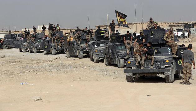 Irakische Sicherheitskräfte vor Mossul (Bild: Associated Press)