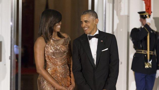 Michelle und Barack Obama (Bild: EPA)