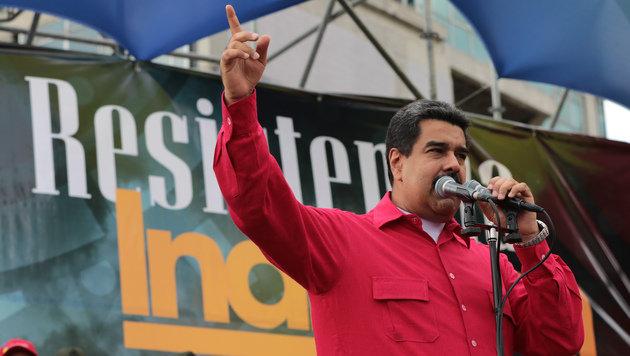 Präsident Maduro klammert sich mit allen Mitteln an die Macht. (Bild: APA/AFP/Venezuelan Presidency)