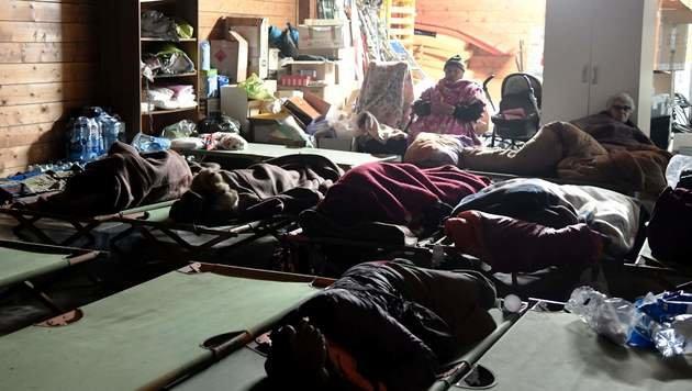 Eine Notschlafstelle in Visso (Bild: APA/AFP/TIZIANA FABI)