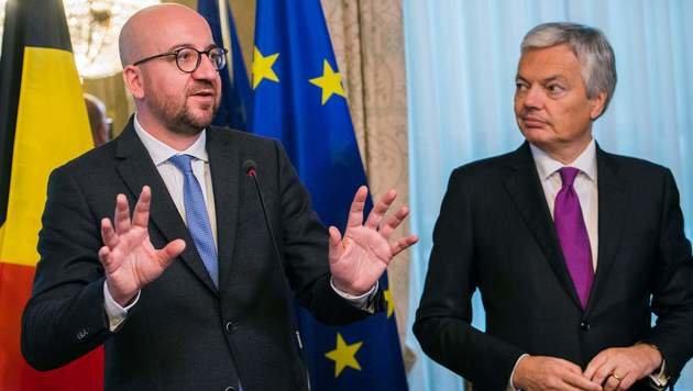 Belgiens Premier Charles Michel (li.) und Außenminister Didier Reynders (Bild: APA/AFP/BELGA/LAURIE DIEFFEMBACQ)