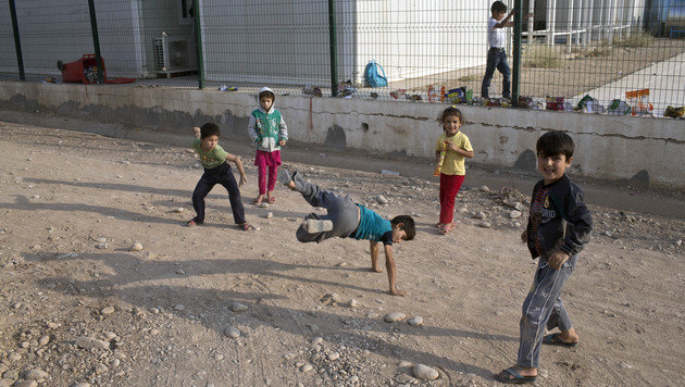 Harmlos spielende Kinder sind die Opfer der Dschihadisten. (Bild: The Associated Press)