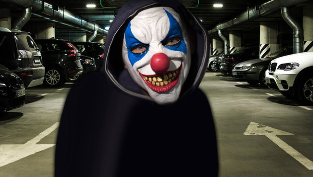 Horror-Clown lauerte Frau in Garage auf (Bild: APA/dpa/Boris Roessler, thinkstockphotos.de)