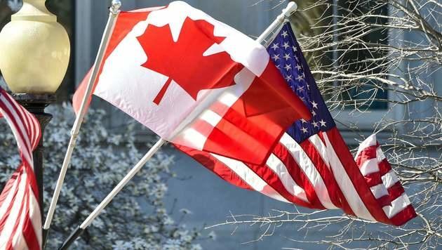 Kanadas Website für Einwanderung lahmgelegt (Bild: APA/AFP/NICHOLAS KAMM)