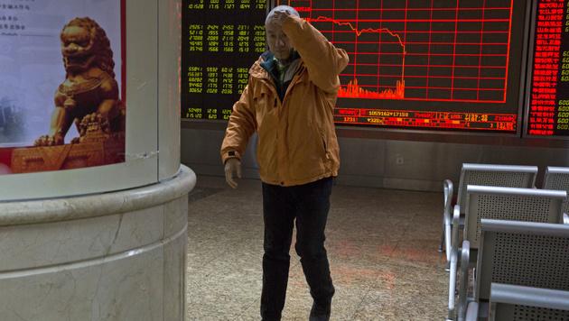 Kursverfall auch an der Börse in Peking (Bild: AP)