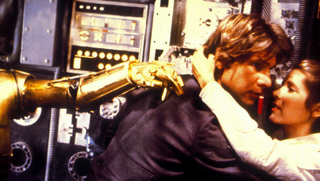 "Harrison Ford und Carrie Fisher in ""Star Wars"" (Bild: Moviestore Collection/face to face)"