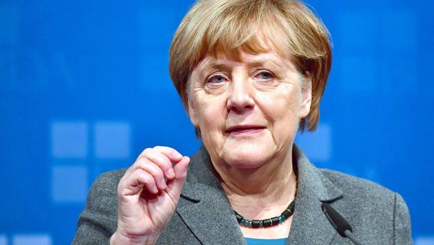 CDU-Grande: Merkel tritt erneut als Kanzlerin an (Bild: APA/AFP/JOHN MACDOUGALL)