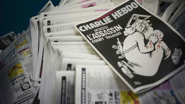 """""""Charlie Hebdo"""" mit Sonderheft zum Jahrestag (Bild: APA/AFP/MARTIN BUREAU)"""