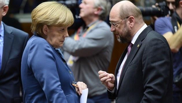 Kanzlerin Angela Merkel, SPD-Chef Martin Schulz (Bild: LIONEL BONAVENTURE/AFP/picturedesk.com)