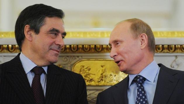 Fillon und Putin (hier im Jahr 2011) haben sich schon oft persönlich getroffen. (Bild: APA/AFP/AFP POOL/NATALIA KOLESNIKOVA)
