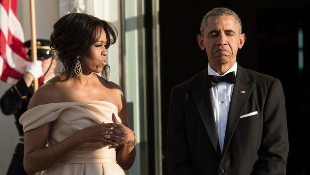 Michelle und Barack Obama (Bild: APA/AFP/NICHOLAS KAMM)