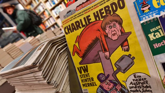 "Merkel strippt in ""Charlie Hebdo"" für freie Welt (Bild: APA/AFP/John Macdougall)"