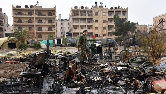Aleppos Altstadt von syrischer Armee erobert (Bild: APA/AFP/GEORGE OURFALIAN)