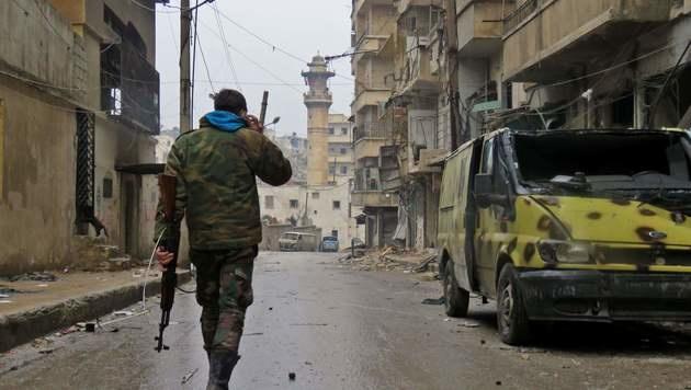 Nebuloser Assad-Deal: Rebellen geben Aleppo auf (Bild: APA/AFP/STRINGER)