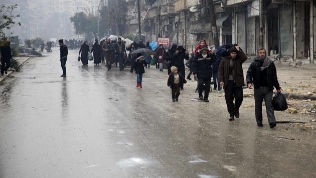 Nebuloser Assad-Deal: Rebellen geben Aleppo auf (Bild: APA/AFP/KARAM AL-MASRI)