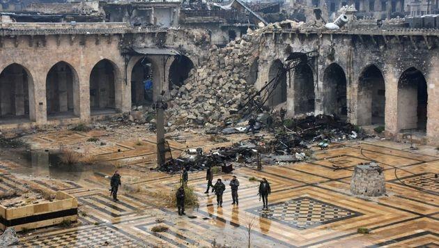 Nebuloser Assad-Deal: Rebellen geben Aleppo auf (Bild: APA/AFP/GEORGE OURFALIAN)