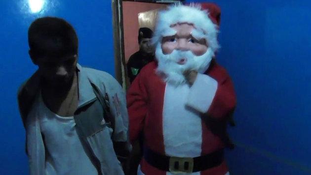 Polizist verhaftet in Santa-Claus-Kostüm Dealer (Bild: AFP)