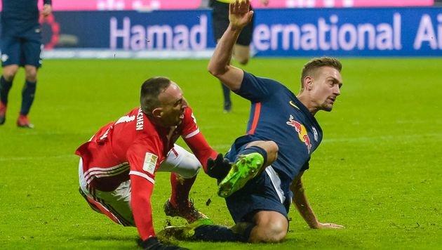 Stefan Ilsanker gegen Franck Ribery (Bild: AFP)