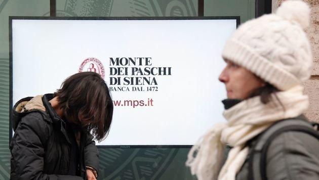 Wegen der Verstaatlichung der Monte dei Paschi müssen sich die Steuerzahler warm anziehen. (Bild: APA/AFP/TIZIANA FABI)
