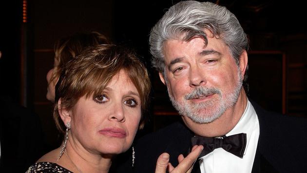 """Fisher 2005 mit """"Star Wars""""-Erfinder George Lucas (Bild: AFP)"""