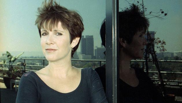 Fisher schrieb neben ihrer Schauspielerei mehrere Romane und arbeitete auch an Drehbüchern mit. (Bild: AP)