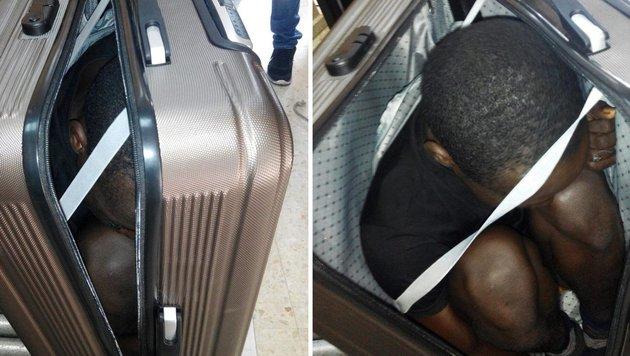 In einem Koffer versteckt wollte dieser Mann illegal in die spanische Enklave Ceuta gelangen. (Bild: EPA)