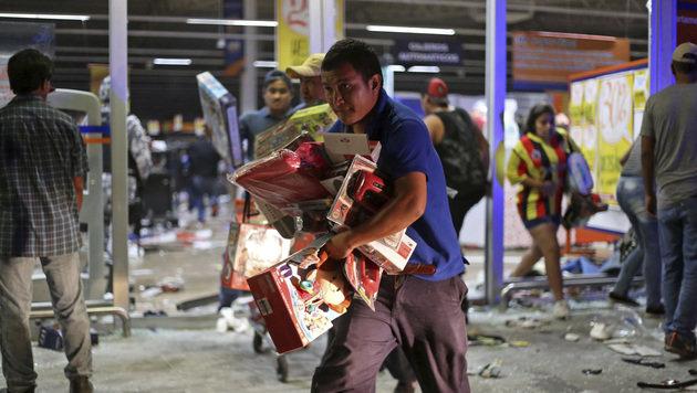 Dutzende Geschäfte in Veracruz wurden ausgeräumt. (Bild: ASSOCIATED PRESS)