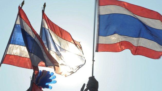 Thai-Flagge geschändet: Südtiroler dürfen heim (Bild: PORNCHAI KITTIWONGSAKUL / AFP / picturedesk.com)