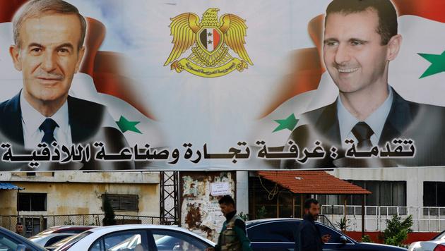 Die syrische Präsidentendynastie Assad (links: Vater Hafiz, rechts: Sohn und Nachfolger Bashar) (Bild: APA/AFP/LOUAI BESHARA)