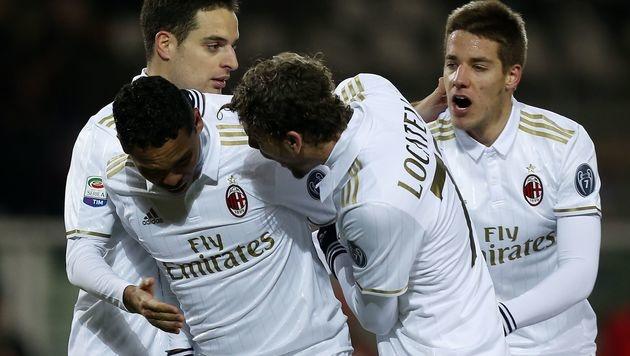 Milan holt nach 0:2 bei Torino noch einen Punkt (Bild: APA/AFP/MARCO BERTORELLO)