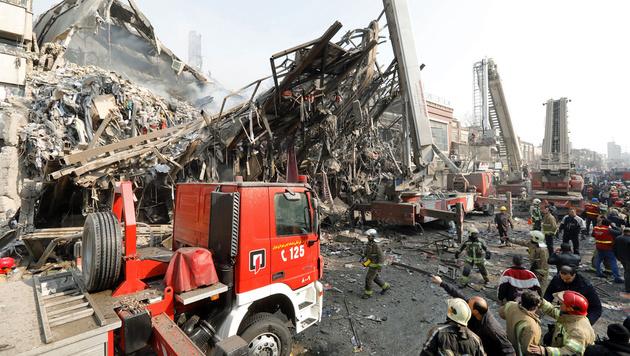 Einkaufszentrum eingestürzt: 20 Helfer getötet (Bild: AFP)