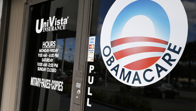 """Ein """"Obamacare""""-Logo auf der Tür eines Versicherungsbüros in Miami (Bild: AFP)"""