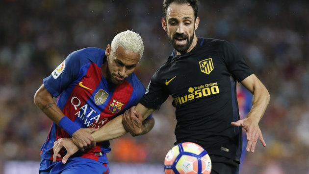 Topduell: Barcelona gastiert bei Atletico Madrid! (Bild: APA)