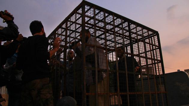 Gefangene in einem Käfig in der syrischen Hauptstadt Damaskus (Bild: AFP)