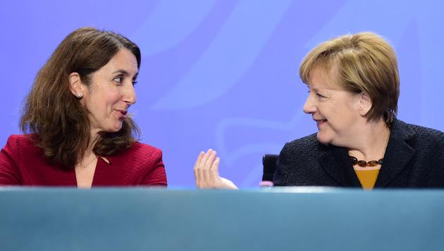 Aydan Özoguz und Angela Merkel (Bild: AFP)