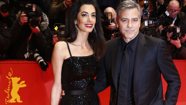 George Clooney mit seiner Amal (Bild: AP)