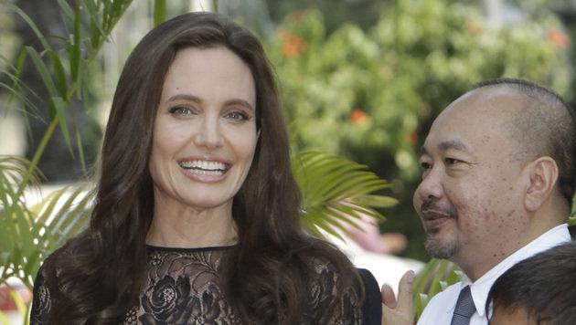Angelina Jolie mit dem kambodschanischen Filmemacher Rithy Panh (Bild: ASSOCIATED PRESS)