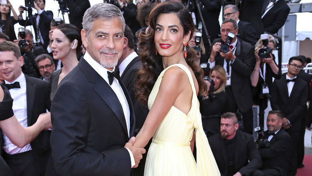 George Clooney mit Ehefrau Amal (Bild: Timm/face to face)