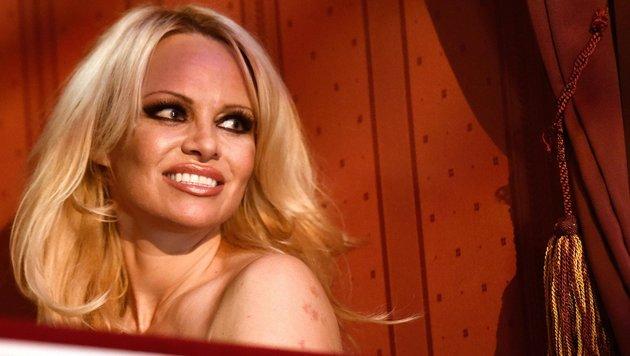 Ex-Nixe Pamela Anderson völlig verbotoxt in Cannes (Bild: APA/HELMUT FOHRINGER)