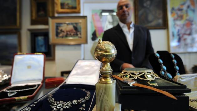 Yossi Dina hat auch schon Golden Globes als Pfand von Stars genommen. (Bild: AFP)